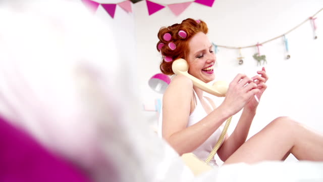 Girl Filing Her Nails and Talking On the Telephone video