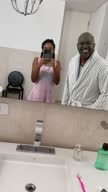 istock Girl filming father with facial mud at home - camera point of view 1311655561