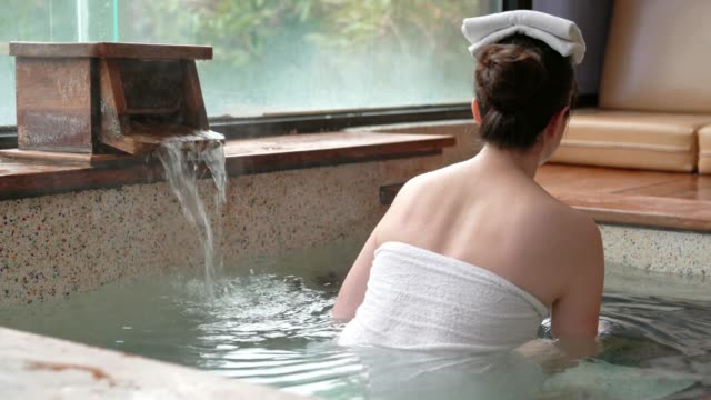 girl avsluta den varma vår stående - japanese bath woman bildbanksvideor och videomaterial från bakom kulisserna