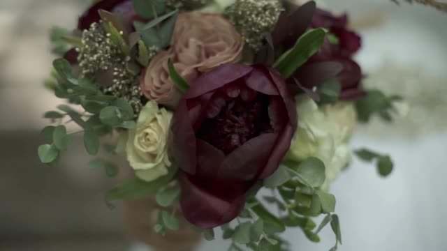 girl goes with a bouquet of flowers girl goes with a bouquet of flowers slowmotion sepia toned stock videos & royalty-free footage