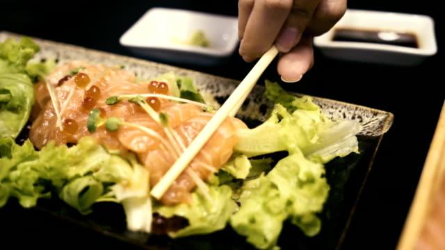 Girl Hand eating Salmon salad video