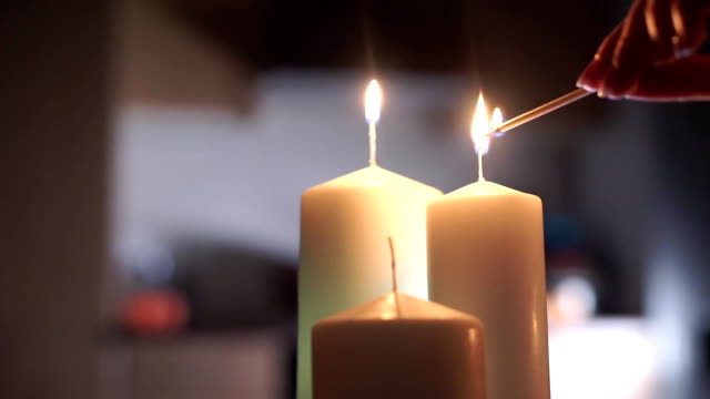 Girl hand lighting up three candles Girl hand lighting up three candles clip candle stock videos & royalty-free footage