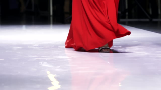 Girl heels red dress sexy step foot close up defile catwalk woman slow motion 4K video