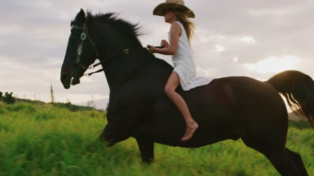 Girl horseback riding in dress