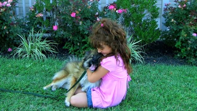 Girl Hugging Dog video