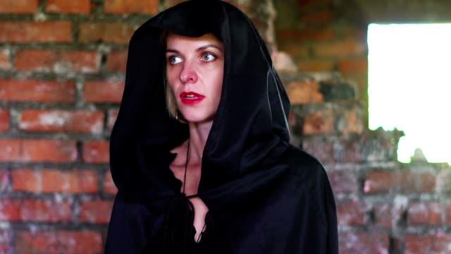 girl in a black cloak in the wreck