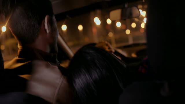 Girl in a car leaning on boyfriend video