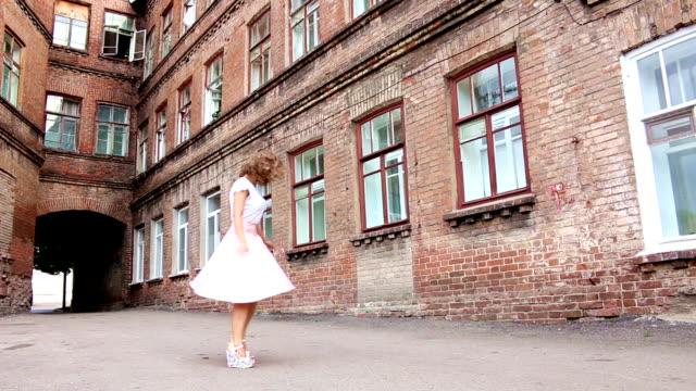 Girl in pink dress swirls in the yard video