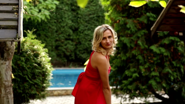 girl in red dress posing in the park - aftonklänning bildbanksvideor och videomaterial från bakom kulisserna