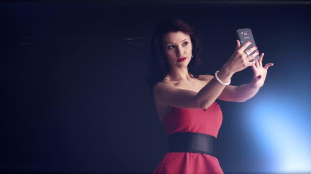 Girl in red dress takes selfie video