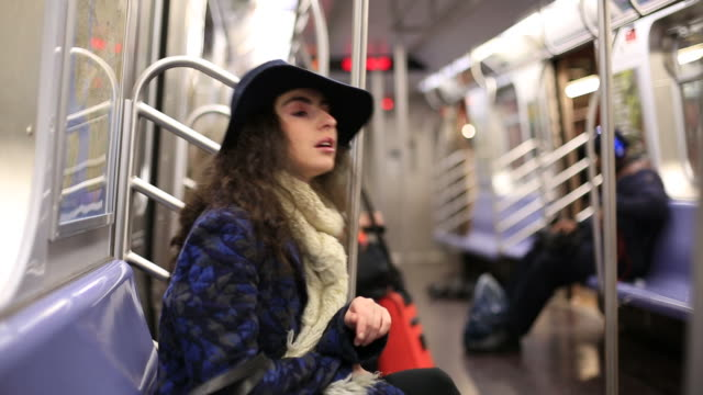 Girl in Subway Series of footage of a subway commuter (female).  seat stock videos & royalty-free footage