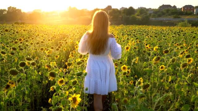 Girl in sunflowers field