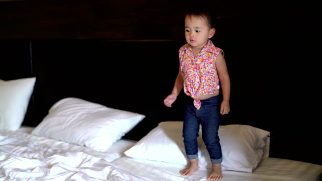 Girl in tutu jumping on bed Details video