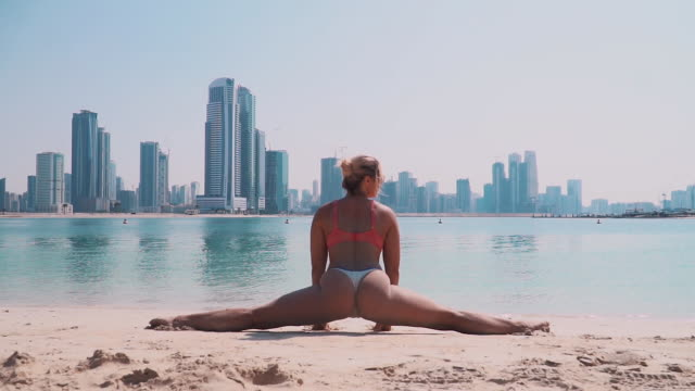 A Girl in Twine on the Background of the Sea in Dubai