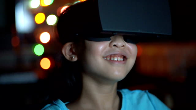 CU Girl in Virtual Reality Glasses. Close of shot of Young Asian Girl in VR headset. simulator stock videos & royalty-free footage