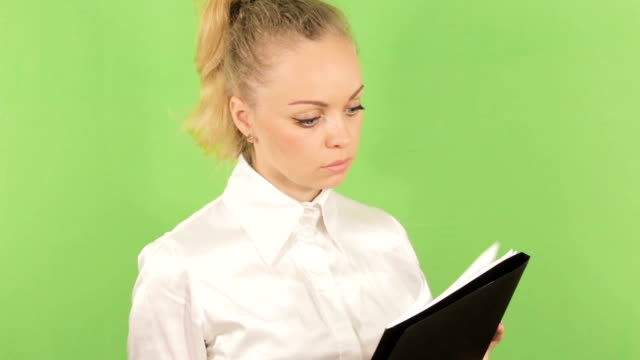 Girl in white blouse posing with documents in the business centre video