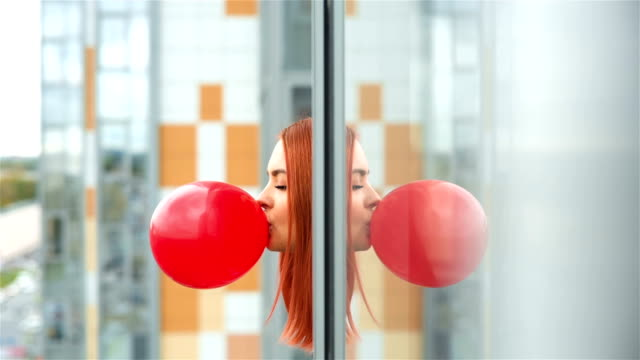 Girl Inflates A Red Bubble Gum video