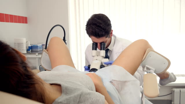 A girl is being examined by a gynecologist at a clinic video