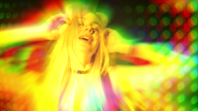 Girl is glowing a tons of colors and dancing in club Girl is glowing and dancing in a nightclub with a ton of lasers and color lights, moving in slow mo and have a real fun russian ethnicity stock videos & royalty-free footage