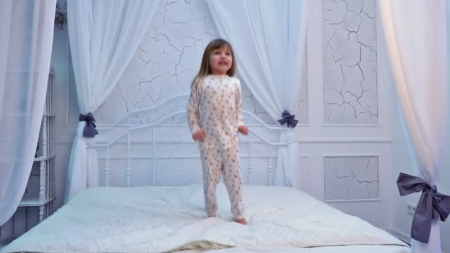 Girl is jumping on the bed video