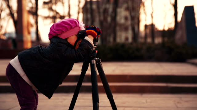 Girl is Photographing by Tripod video