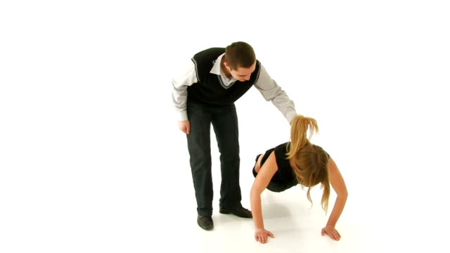 Girl is pushed off floor, guy holding her by hair. video