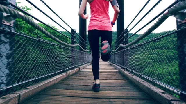 Girl jogging at the bridge video
