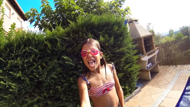 Girl jumping into swimming pool video
