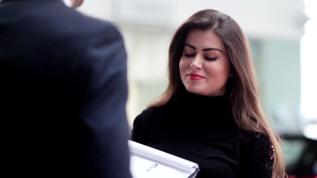 Girl listening attentively to contract terms