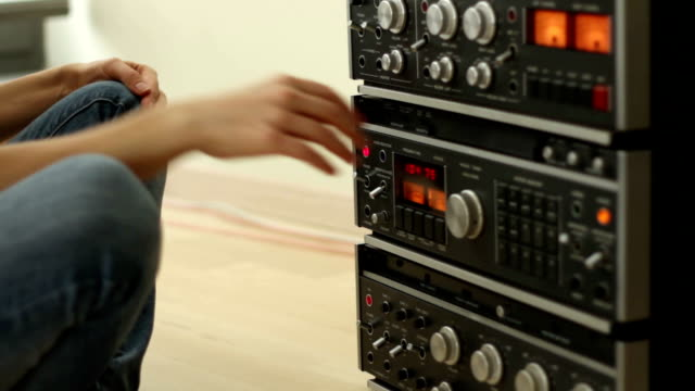 Girl listening to music from retro audio tape recorder video