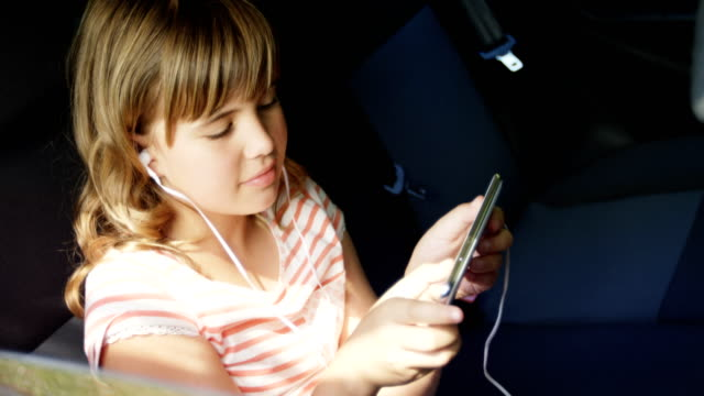 Girl listening to music on mobile phone video