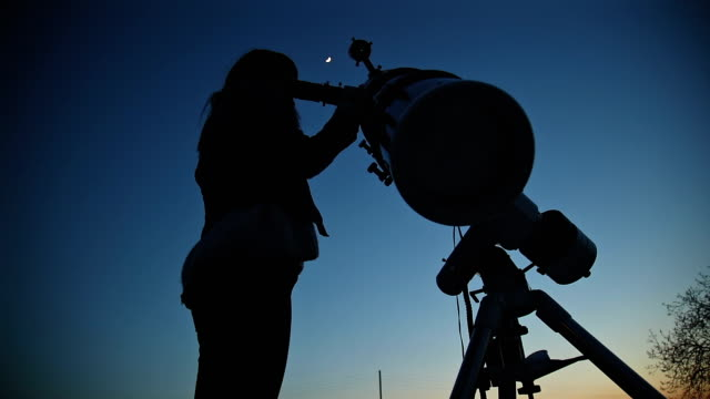 Girl looking at the Moon through a telescope. My astronomy work. video