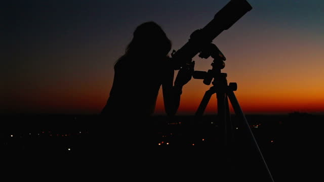 girl looking at the stars through a telescope. - astronomia video stock e b–roll