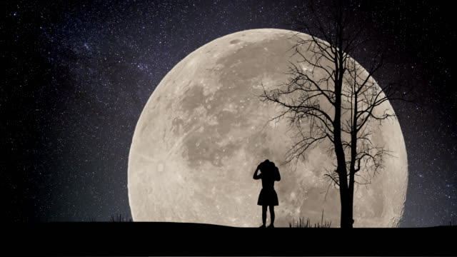 girl looking night stars time lapse with supermoon background - moon stock videos & royalty-free footage