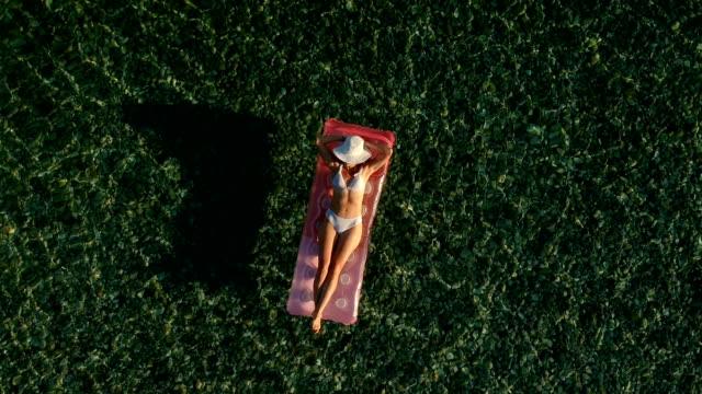 Girl lying on the mattress,aerial shot video