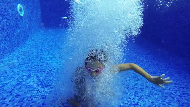 Girl making a heart shape underwater video