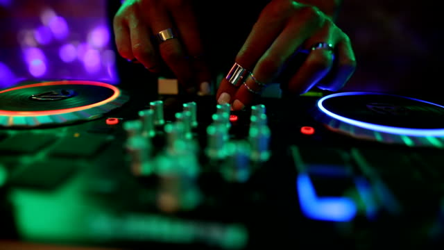 dj girl mixing modern turntable. dj hands on mixer, dancing and playing music, close up - funky video stock e b–roll
