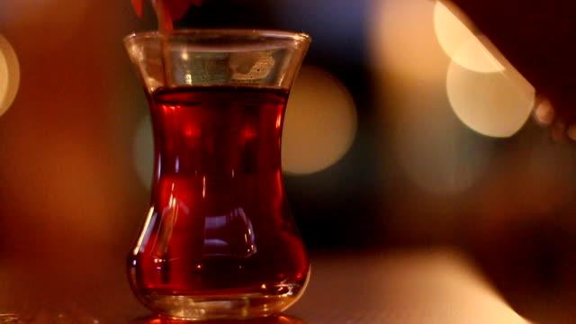 girl mixing turkish tea - турция стоковые видео и кадры b-roll