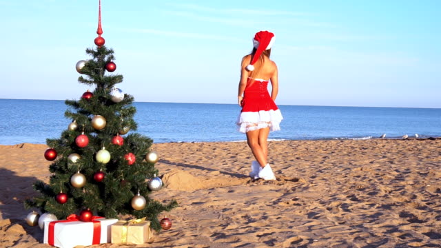 girl on beach resort in Christmas clothes for the new year 1 video
