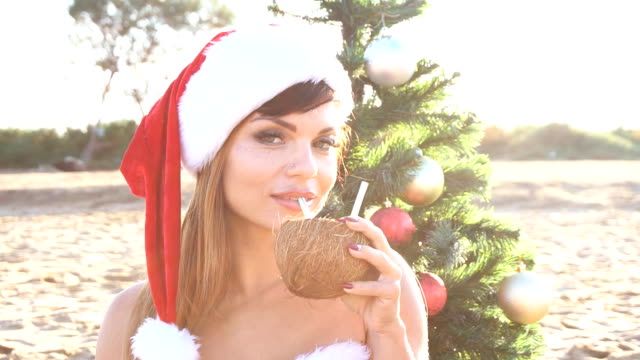 girl on beach resort in Christmas clothes for the new year in the tropics video
