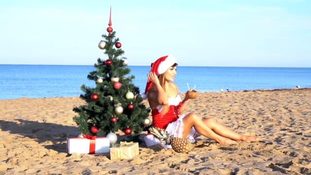 girl on beach resort in Christmas clothes for the new year video