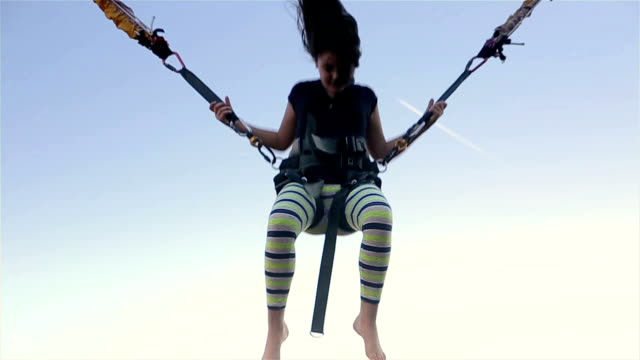 girl on bungee jumping - bungee jumping video stock e b–roll