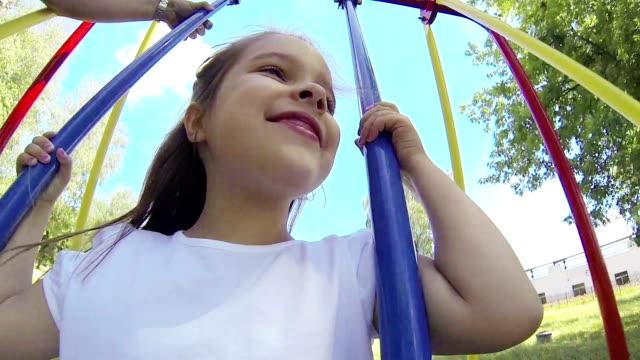 girl on swing - endast flickor bildbanksvideor och videomaterial från bakom kulisserna