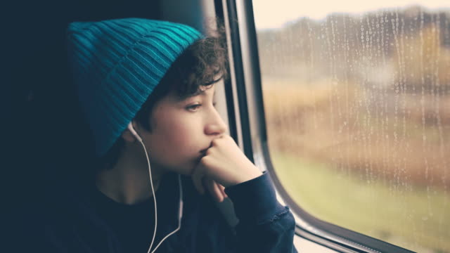 Girl on Train looking through window video