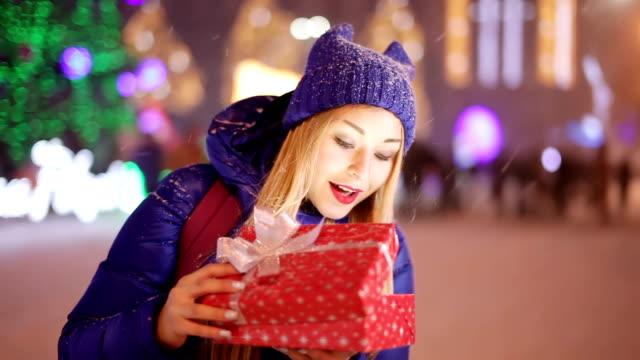 Girl open illuminated giftbox video