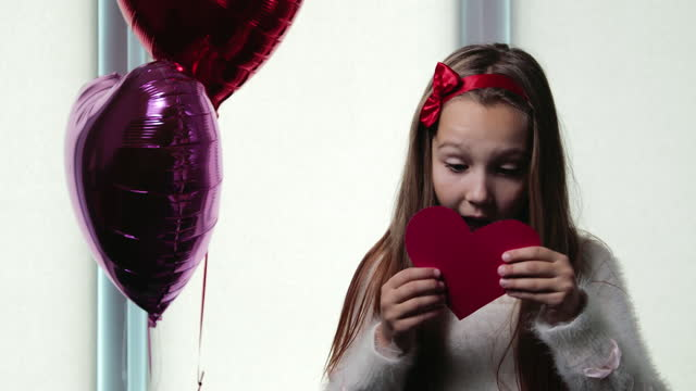 Girl opened an envelope with the inscription I love you on Valentine's Day
