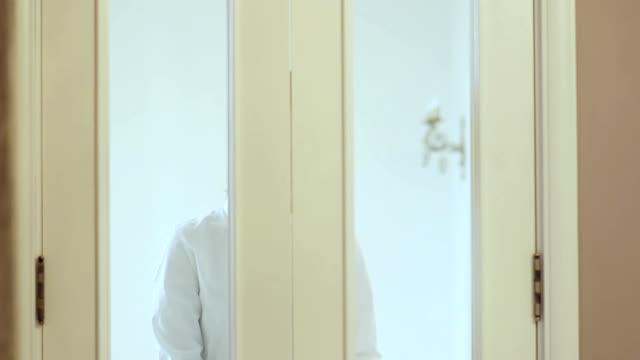 Girl opens beautiful classic door, leaves the room video