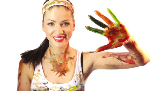 girl paints handprint at camera video
