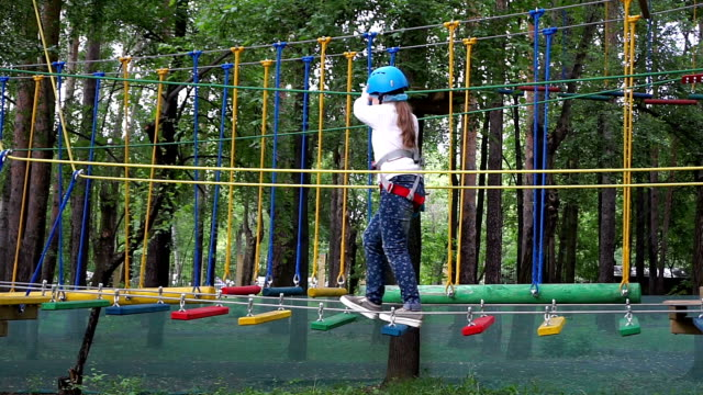 girl passes a rope obstacle course video