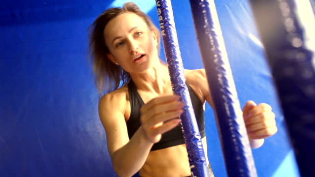 girl performs abs workout through the ropes in the Boxing ring girl performs abs workout through the ropes in the Boxing ring expressionism stock videos & royalty-free footage